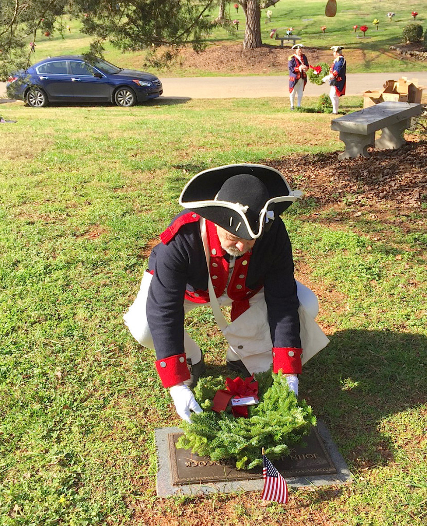 Mecklenburg chapter vice president Ken Luckey lays a wreath for a Veteran on December 12, 2015 at Forest Lawn East Cemetery in Matthews, NC.