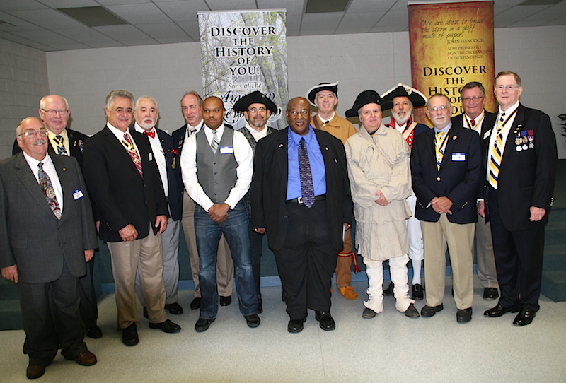 (Members of the NCSSAR pose with new SAR Compatriot Edward E. Carter, center in blue suit.)