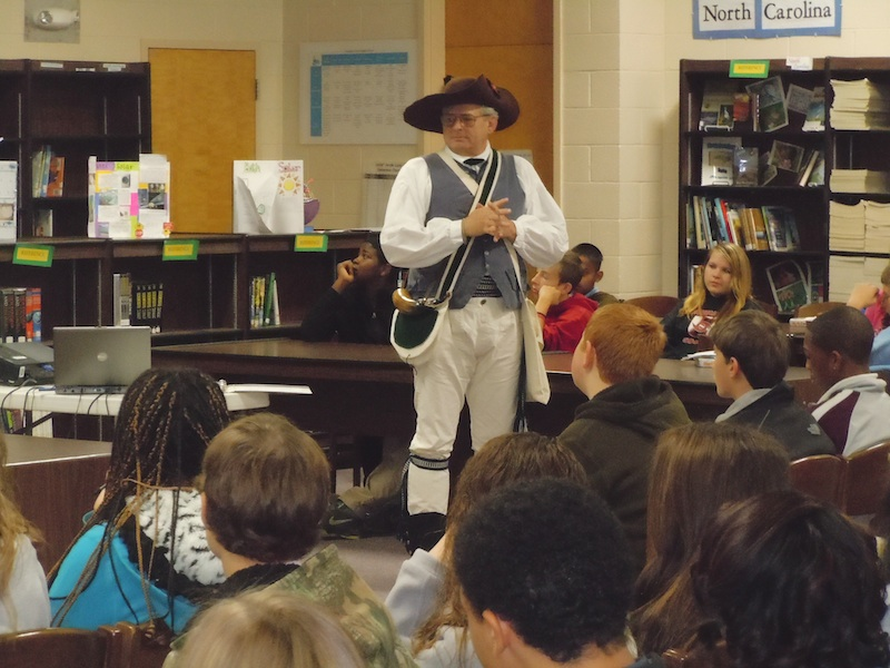 SAR Halifax Resolves chapter president Ken Wilson delivers a presentation to school students about the Revolutionary War.
