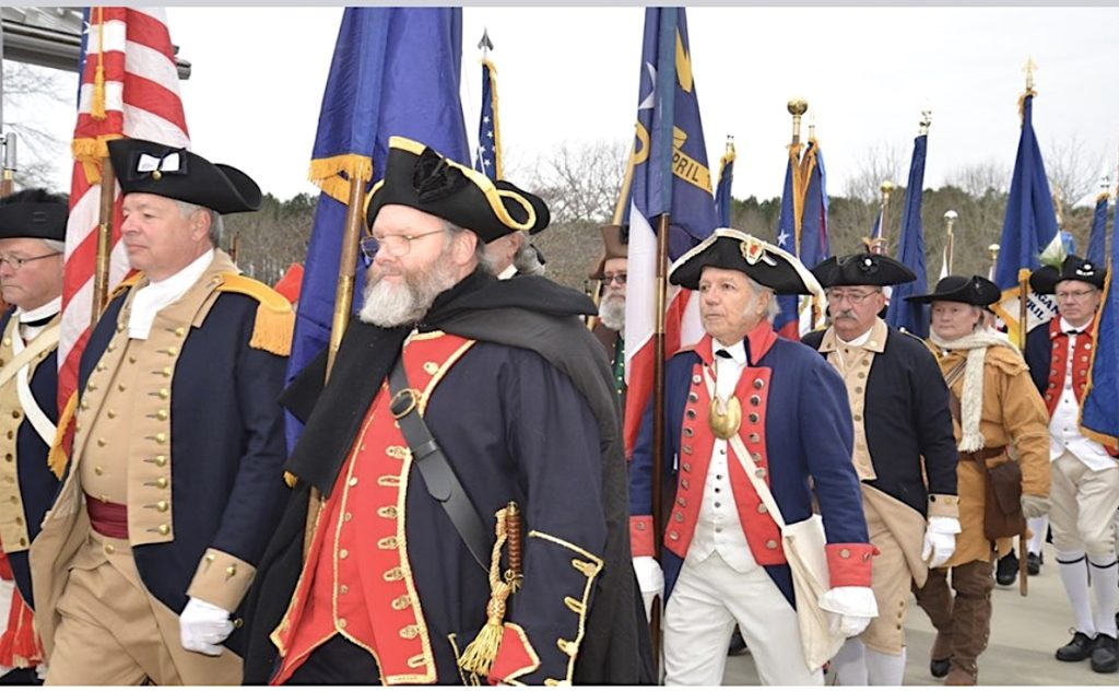 Gen George Washington SAR chapter president George Strunk carries the NC State Flag at the Annual Battle of Cowpens ceremony in Gaffney, SC, on January 18, 2020.